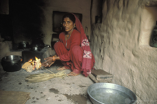 Photo of a woman using a cookstove.