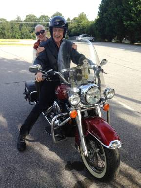 Jane Goodall and Francis Collins on a motorcycle