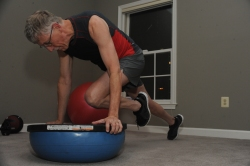 Man exercising with a BOSU ball