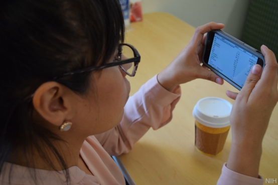Woman looking at electronic medical records on her smartphone