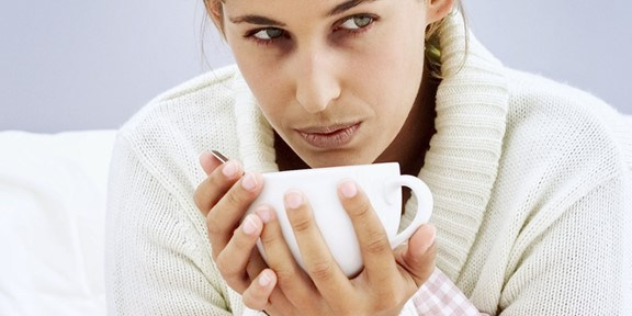 feedacoldfeatureimagecollinsfsWoman eating hot soup in bed